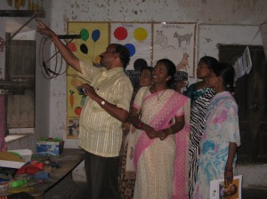 Teachers from Rama Bhaskara Bharatiya School examining classrooms