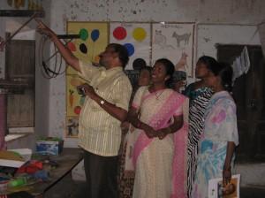 Teachers from Rama Bhaskara Bharatiya School examining classrooms