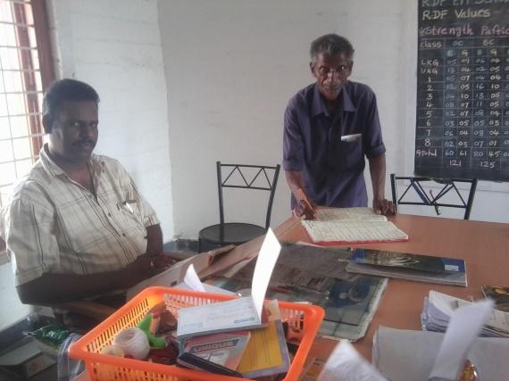 Obanna signing the attendance register