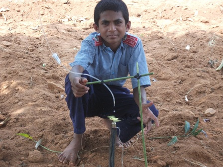 Rajesh with his hand made sprinkler system