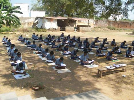 Students writing their exams without invigilation by the teachers