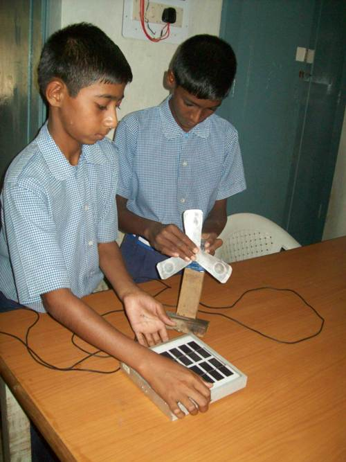 Students making the solar powered fan