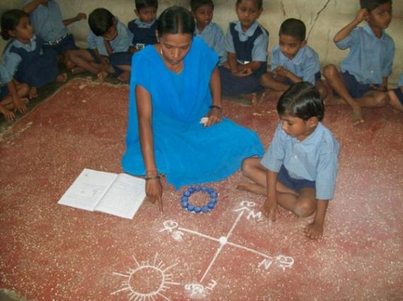 R. Anitha teaching the class