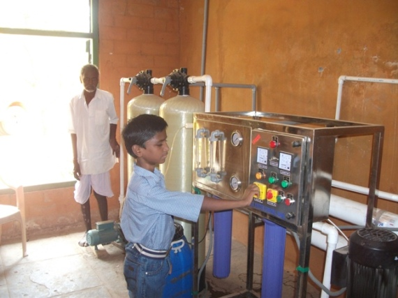 Ashok operating the water plant