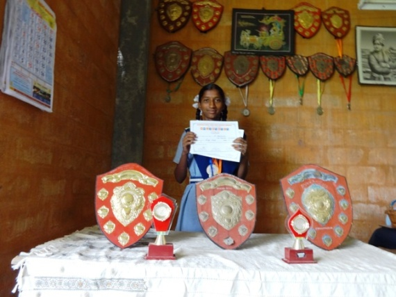 Santhosha with her medals and certificates