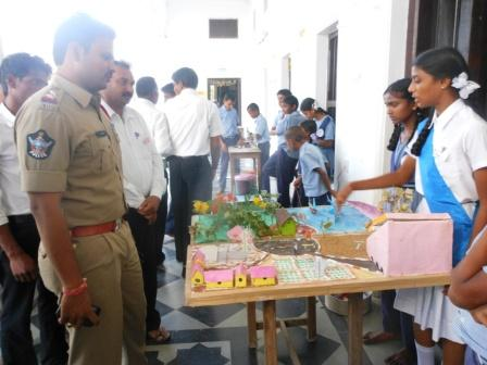 Parvathigiri Sub Inspector observing the exhibits