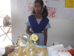 Srujuna with her innovative lamp