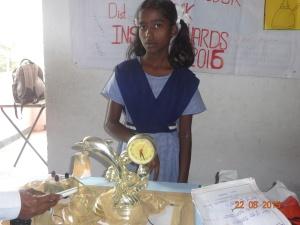 Srujuna with her innovative lamp