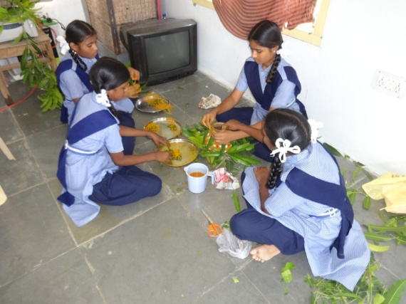 RS students working with traditional materials for Ganesh puja & celebrations