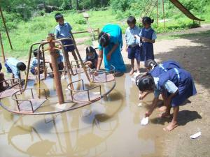 Children plying rain water with boats.2