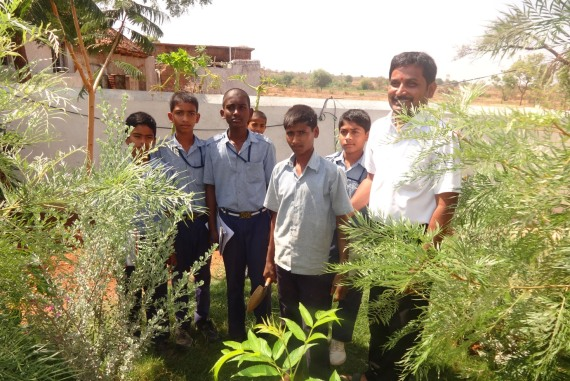 Students with the school Headmaster, discussing the importance of organic plantations
