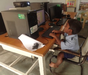 Eswar working on a computer in the school