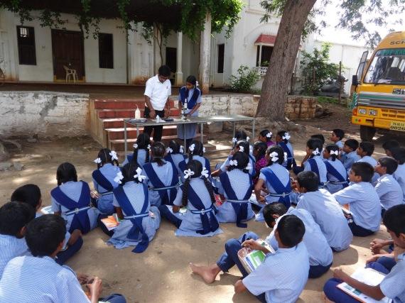 Science Teacher, Mr. Ramesh, showing 'Lactobacillus' experiment