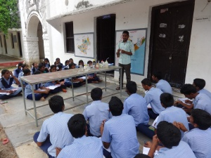 Physics teacher, Mr. Venu, demonstrating 'Acids & Bases'