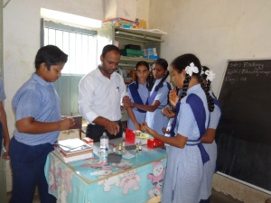 Biology teacher, Mr. Santhosh, testing Blood Groups in Biology