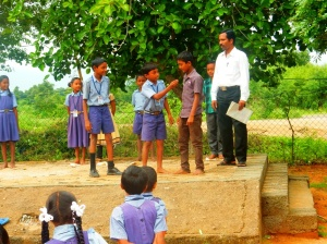 A group of primary students performing a skit