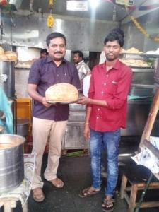 Narsimlu (R) with Matendla School Headmaster, Mr. Vishnumurthy, at his canteen