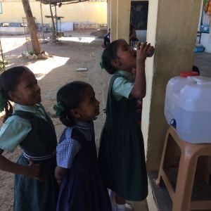 Little children drinking clean & filtered water