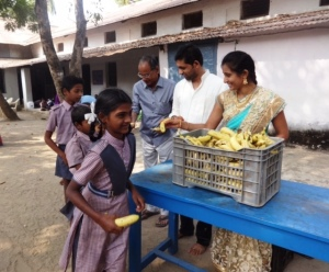 Bananas being served during the Annadanam